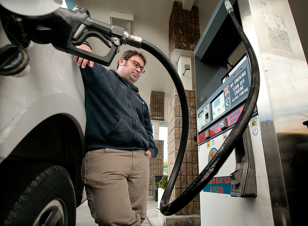 Seth Heller fills up at the Golden Bay gas station in downtown Oakland, Calif., on April 8th,  2011.