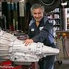 Henry Villanueva installing a transmission