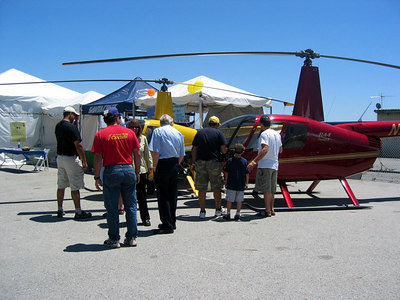 The R44 drew a lot of attention. Frank and his pilot Ginger are in front of the R22.