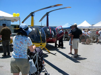 The yellow R22, the red R44 next to Golden Gate Helicopters' booth.