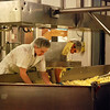 "Kayla Rice/Reformer               <br /> Employees at the Grafton Village Cheese Company bring the cheese through its ""cheddering"" process."