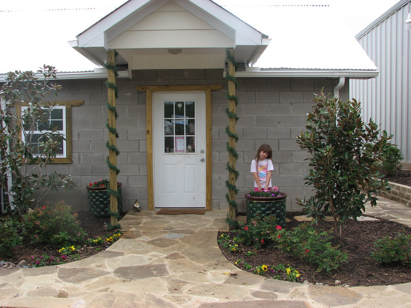 MAIN ENTRANCE TO KENNEL OFFICE - <br /> Ruben Martinez (our friend, Landscape designer & Architectural designer) and his wife Margo brought us these beautiful pots from Mexico for Christmas!! Faith and I filled them with annual color - Geraniums and Petunias!!