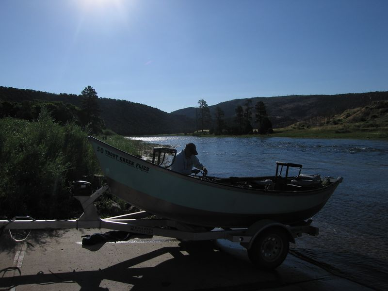 Chuck, guide for Bob and Gary, unloading his drift boat