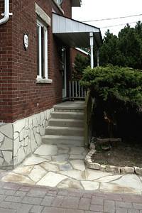 Flagstone walkway with lionshead edge.