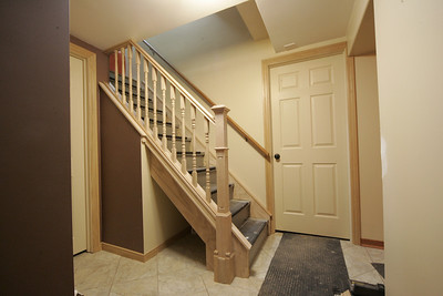 Capting stairs with oak. Next to cap the steps the replace other rail with matching oak... see movie.