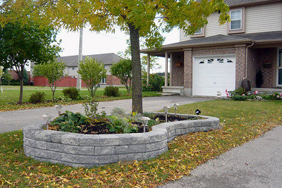 Raised garden with landscaping stones.