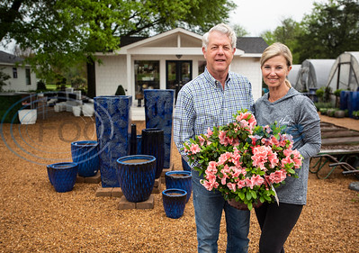 Scott and Karen Hand of Hand Nurseries stand by their large blue pots for plants on Friday, March 20, 2020.
