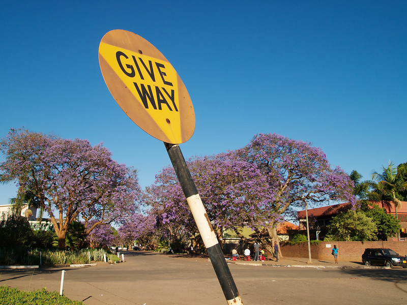 One of the many signs of urban decay in Harare - a crucked and fading give way sign.