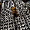 KRISTOPHER RADDER — BRATTLEBORO REFORMER<br /> Pallets of empty cans wait to be filled as the new operation is able to produce 450 cases a week from the 70 cases per week at the downtown location.