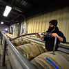 KRISTOPHER RADDER — BRATTLEBORO REFORMER<br /> Chuck Socy, cellars manager and sustainability coordinator, moves a beer that was the age for a year and a half into the conditioning tanks before workers can bottle it the following week.