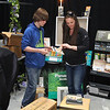 The Central Mass. Home Show, opens at the Wallace Civic Center in Fitchburg, Friday at 5 p.m. Jaxon Aiesi, 13, helps his mom Jennifer Aiesi set up the booth for Needham Lighting Center out of Fitchburg on Thursday at the show.  SENTINEL & ENTERPRISE/JOHN LOVE