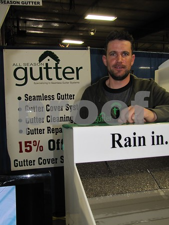 Shane Schnittger of All Season Gutter in his booth at the Home & Garden Show.