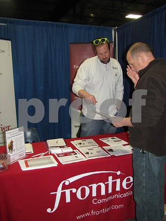 Troy Recker of Frontier answering questions for attendees to the Home & Garden Show.
