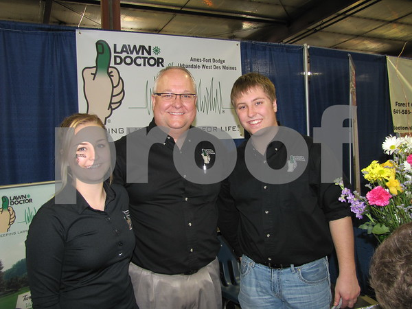 Chloee, Todd, and Jordan Narber of Lawn Doctor in their booth at The Messenger's Home & Garden Show.