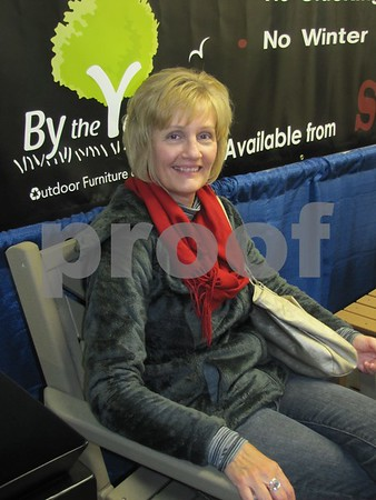Liza Marchant enjoys a break in one the patio chairs on display at the Home & Garden Show.