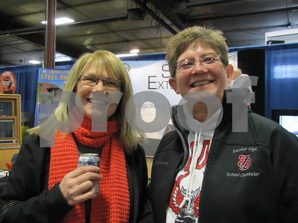 Cathy Hugghins and Peg Christensen were enjoying visiting all the booths at The Messenger's Home & Garden Show.