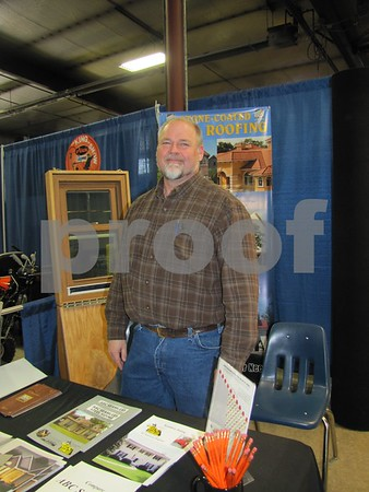 Jeff Helvick of Satern Exteriors at his booth at the Home & Garden Show.