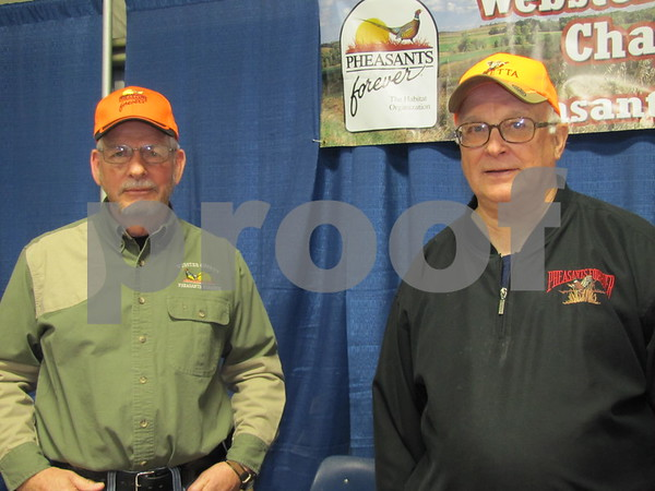 Steve Page and Jerry Beck of Pheasants Forever were selling raffle tickets for items and tickets for their upcoming fundraiser.