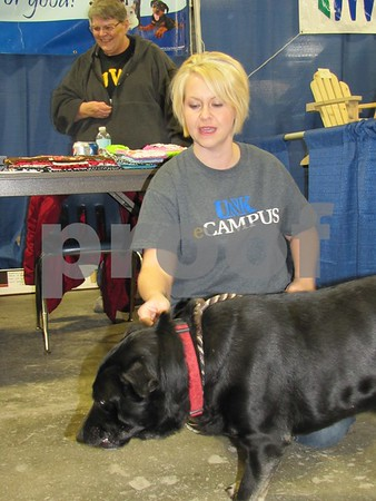 """Biggy"" the dog with Jenny Gernhart.  ""Biggy"" was a most friendly fellow and is eager to be adopted."