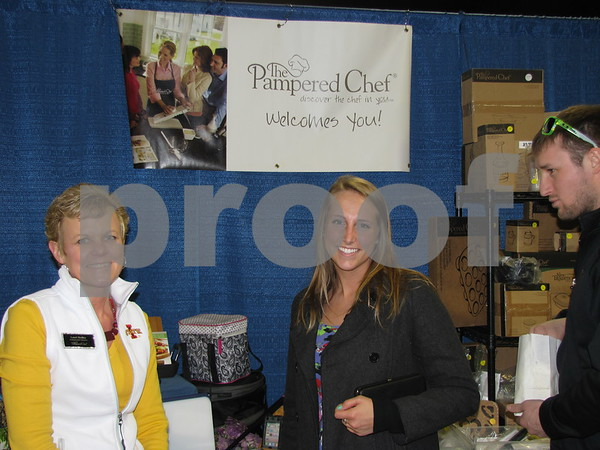 Lauri Beilke of Pampered Chef visits with Chelsea Meyers and Joe Heatherington.