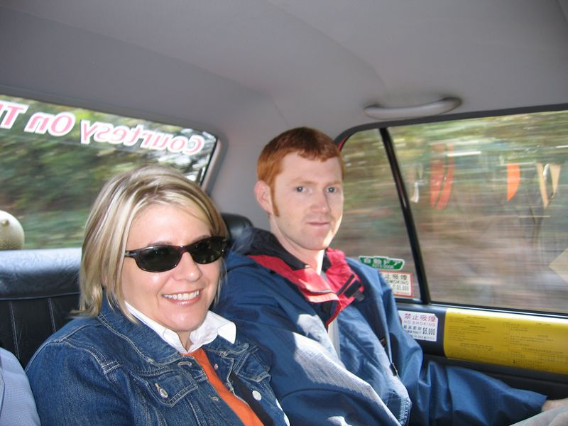 Kelly and Neil in the back seat of the taxi