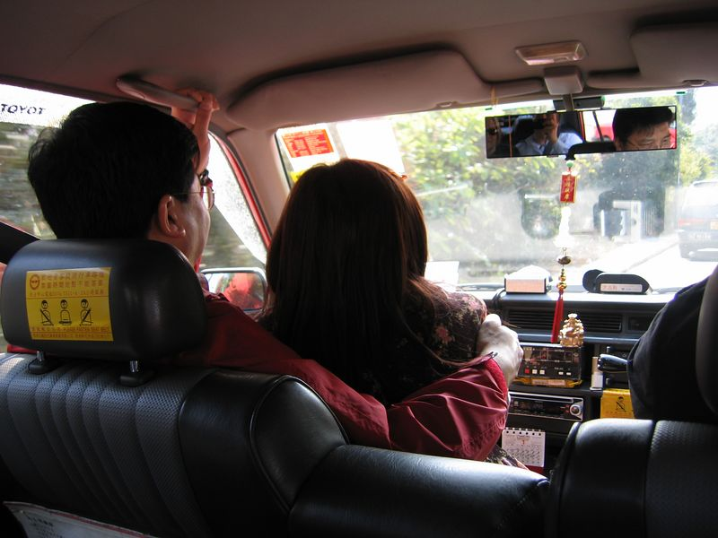 Simon and Ella in the front seat of the taxi