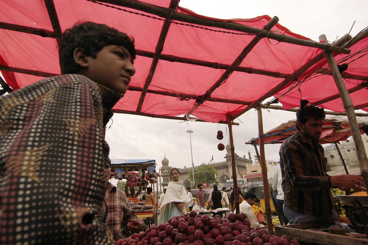 Kid selling fruit.