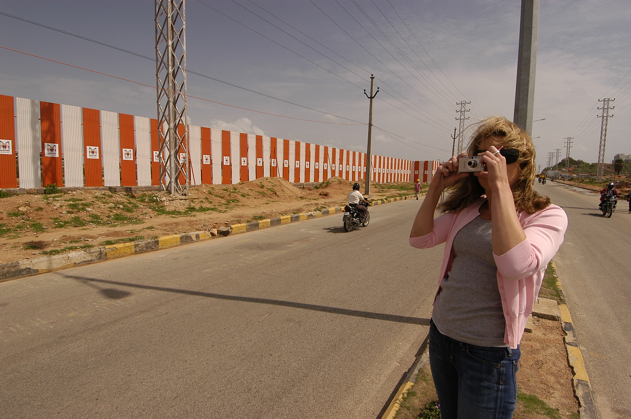 Alison in front of Mantri's resi site in Hyderabad