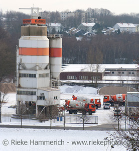 "Gelsenkirchen, Germany - December 30, 2005: Concrete manufacturing plant ""Readymix Beton"" with parked trucks in Gelsenkirchen, Germany. Readymix Beton is a recognized leader in the production and supply of ready mix concrete."