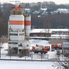 """Gelsenkirchen, Germany - December 30, 2005:<br /> Concrete manufacturing plant """"Readymix Beton"""" with parked trucks in Gelsenkirchen, Germany. Readymix Beton is a recognized leader in the production and supply of ready mix concrete."""