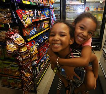 Infante Grocery owners' daughters Skylah Cruz, 8, left, and Nahionys, 6. (SUN/Julia Malakie)