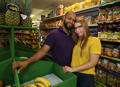 Infante Grocery owners Garibaldi and his wife Dayris Cruz, at the store on Broadway.  (SUN/Julia Malakie)