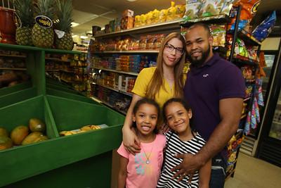 Infante Grocery owners Garibaldi and his wife Dayris Cruz, and their daughters Nahionys, 6, left, and Skylah Cruz, 8.  (SUN/Julia Malakie)