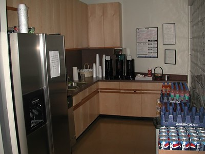 The small kitchen and stacks of sodas.  The sodas were kept in 3 drink stations in the building - the kind you see at the 7-11.