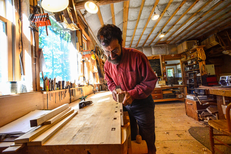Jason Breen, of Jason Breen Fine & Custom,works on a standing desk at his West Brattleboro studio on Monday, Sept. 26, 2016. Breen's studio will be one of many studios opening their doors during a tour. Kristopher Radder / Reformer Staff