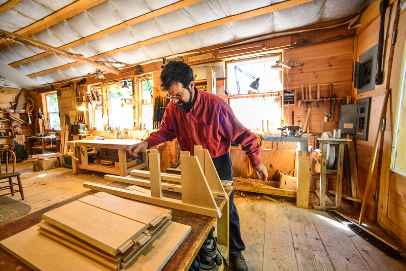 Jason Breen, of Jason Breen Fine & Custom, works on a standing desk at his West Brattleboro studio on Monday, Sept. 26, 2016. Breen's studio will be one of many studios opening their doors during a tour. Kristopher Radder / Reformer Staff
