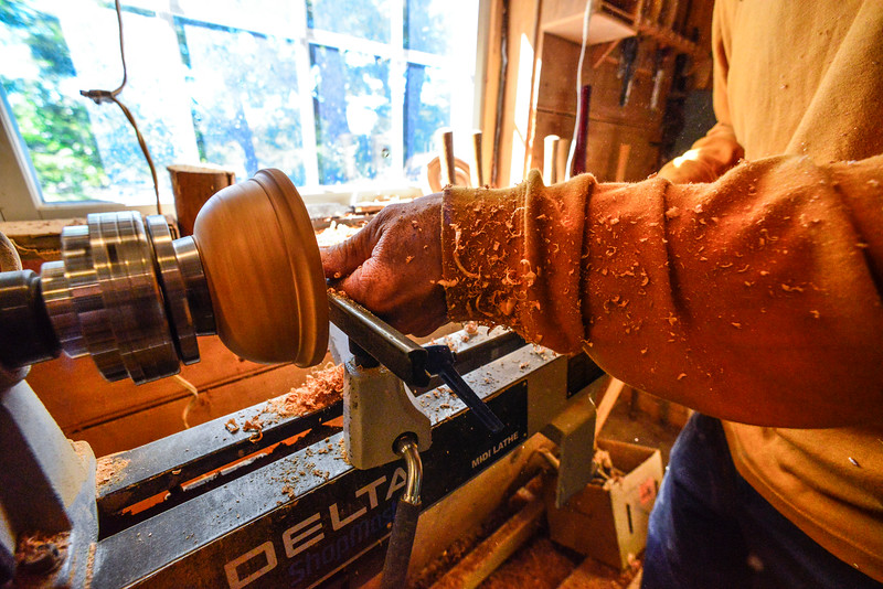 Jason Breen, of Jason Breen Fine & Custom,  uses a lathe while hollowing out the inside of a piece of wood he is working with. Kristopher Radder / Reformer Staff