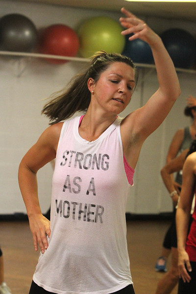 Jazzercise class at Chelmsford studio on Parkhurst Road. It's the 50th anniversary of the dance fitness phenomenon. Abbey Ciardi of Chelmsford, who was taking class with her daughter. (SUN/Julia Malakie)