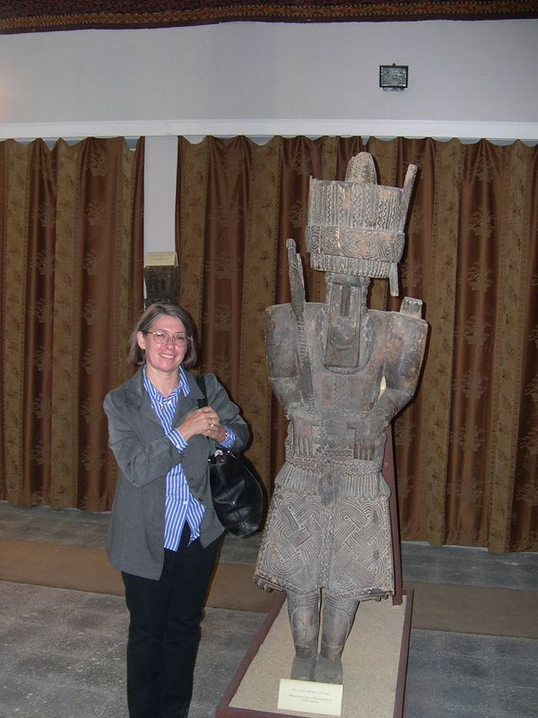 Brigitte next to one of the wooden tribal statues.
