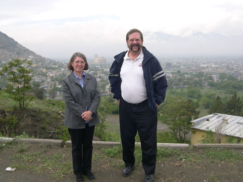 Dick and Brigitte Duces, the Operations Adviser for the South Asia region, on a hill above Kabul, overseeing the city.