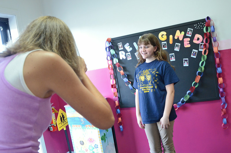 Jordan Salovardos gets her photo taken after signing up for fall classes during an open house at Kathy Roy's School of Dance in Westminster on Wednesday afternoon.  SENTINEL & ENTERPRISE / Ashley Green
