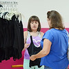 Jocelyn Dias, 11, shops for a new leotard with the help of her mom Brenda during an open house registration held at Kathy Roy's School of Dance in Westminster on Wednesday afternoon.  SENTINEL & ENTERPRISE / Ashley Green