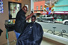 Chris Barton, owner of Klipper Kingz on Eagle Street in North Adams gives a trim to MCLA student Marcus LaFontant' 14. Barton is celebrating five years in business. (Gillian Jones/North Adams Transcript)