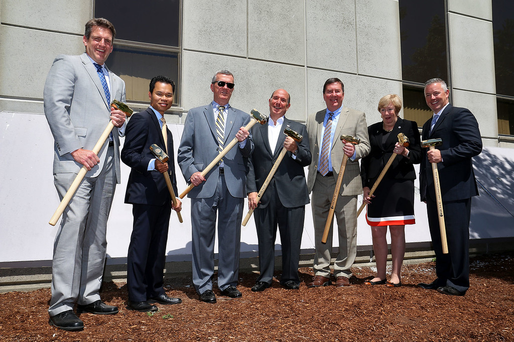 """. A \""""golden sledgehammer\"""" event marking the ceremonial start of a $40 million renovation for the company Kronos, which is moving from Chelmsford to Lowell, was held at Cross Point\'s, the company\'s new home, on Friday morning. Holding the golden sledgehammer\'s for a picture is, from left, MA Secretary of Housing and Economic Development Jay Ash, State Rep. Rady Mom, Lowell City Manager kevin Murphy, Kronos CEO Aron Ain, State Rep david Nangle, MA State Senator Eileen Donoghue and Stae Rep. Tom Golden. SUN/JOHN LOVE"""
