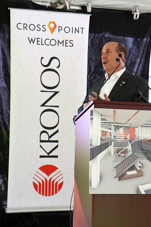 ". A ""golden sledgehammer\"" event marking the ceremonial start of a $40 million renovation for the company Kronos, which is moving from Chelmsford to Lowell, was held at Cross Point\'s, the company\'s new home, on Friday morning. Kronos CEO Aron Ain addresses the crowd during the ceremony. SUN/JOHN LOVE"