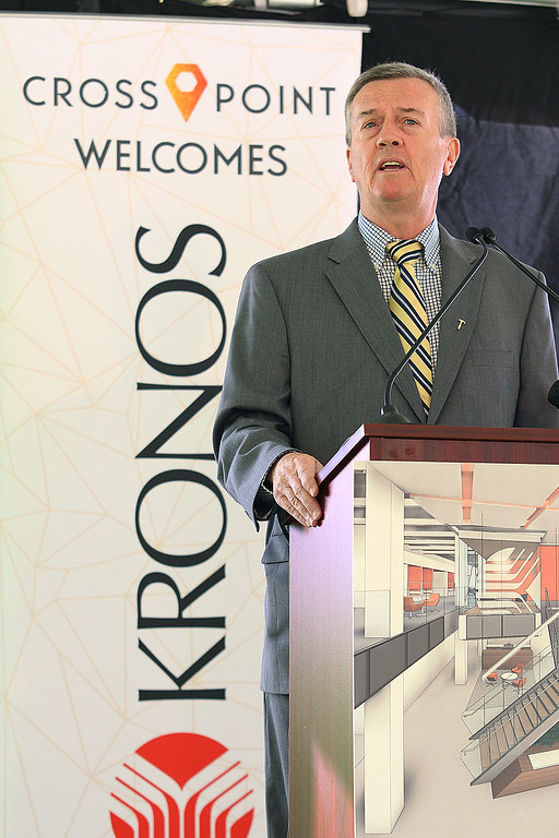 ". A ""golden sledgehammer\"" event marking the ceremonial start of a $40 million renovation for the company Kronos, which is moving from Chelmsford to Lowell, was held at Cross Point\'s, the company\'s new home, on Friday morning. Lowell City Manager Kevin Murphy addresses the crowd. SUN/JOHN LOVE"