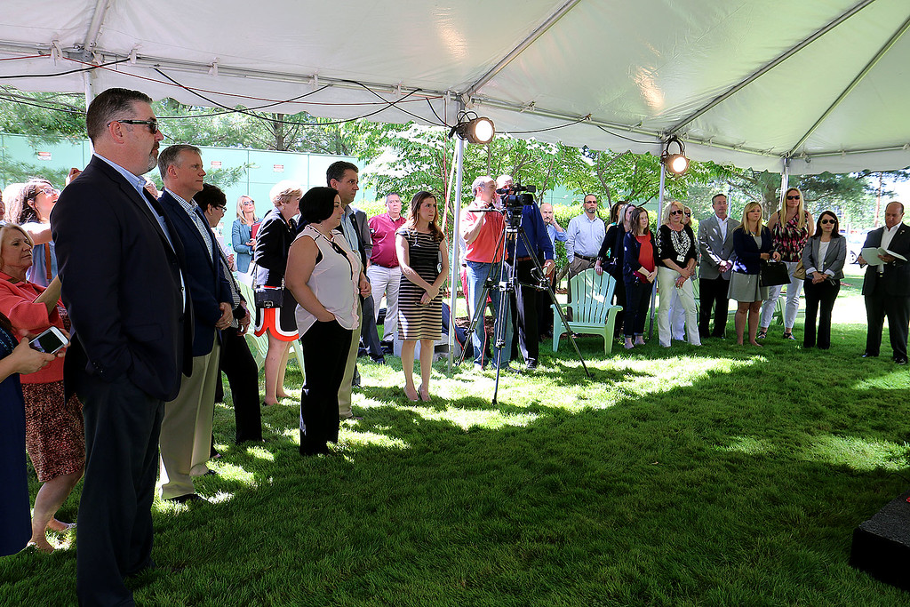 """. A \""""golden sledgehammer\"""" event marking the ceremonial start of a $40 million renovation for the company Kronos, which is moving from Chelmsford to Lowell, was held at Cross Point\'s, the company\'s new home, on Friday morning. Many listen to speakers during the ceremony. SUN/JOHN LOVE"""