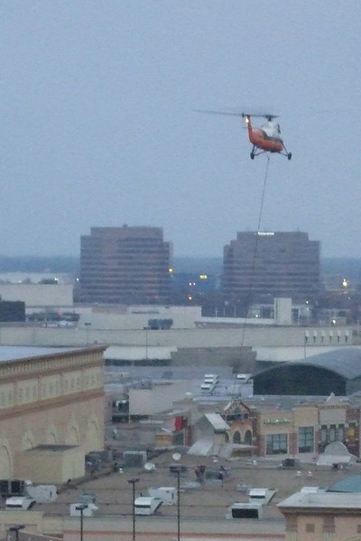 One rainy morning, instead of working, I watched this helipcopter haul palettes from the parking lot to the roof.