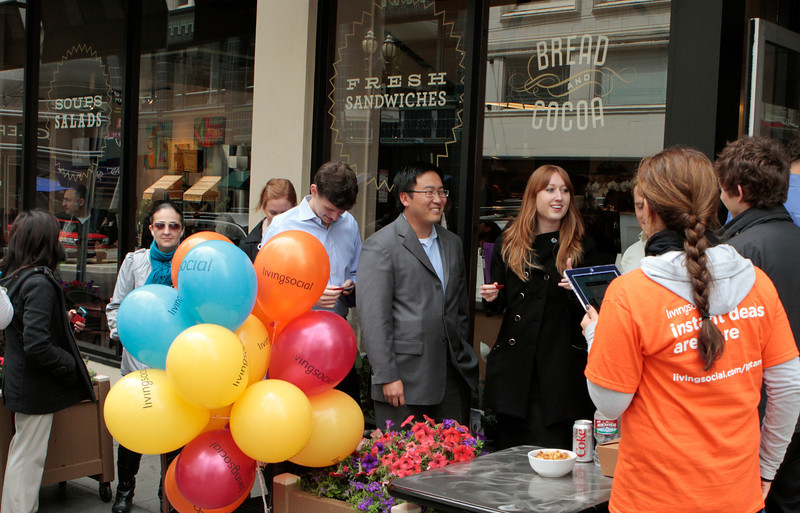 In this photo provided by Living Social, people line up at Bread and Cocoa restaurant to redeem a voucher for LivingSocial's new Instant Deal service on Wednesday, July 13, 2011 in San Francisco. (AP Photo/John Storey, Living Social)