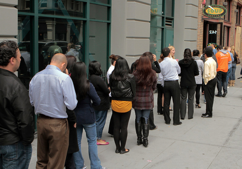 In this photo provided by Living Social, people line up at the San Francisco Soup Company to redeem a voucher for LivingSocial's new instant deal service on Wednesday, July 13, 2011 in San Francisco. (AP Photo/John Storey, Living Social)